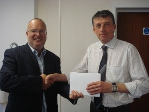 Managing Director Alan Green (left) presents Draightsman Neil Petrie with his gift to recognise Neil's 25 years with Neaco