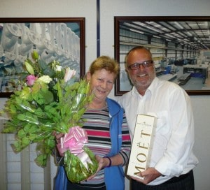Lynda Wilson receives her retirement gift from Neaco Managing Director, Alan Green.