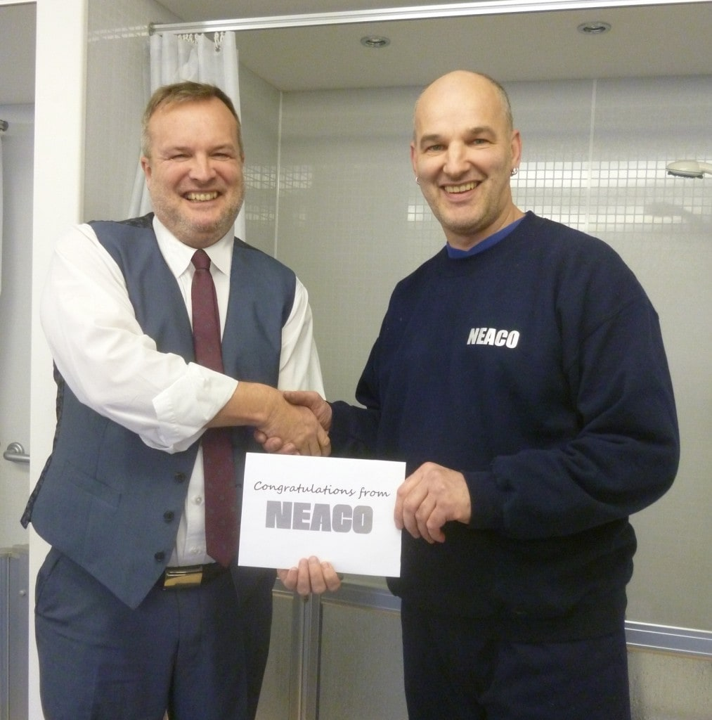 Managing Director Alan Green (left) presents a company gift to Tommy Andrews in recognition of his 25th year with Neaco.