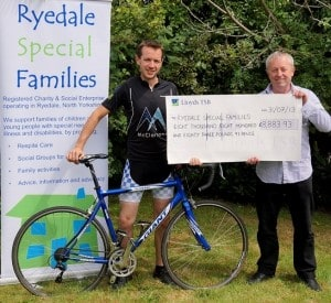Darren Felgate presents the cheque to Rob Davies of the Ryedale Special Families charity